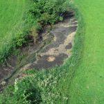 Inšpektorat povzročitelju odredil odstranitev blata v Vodulah